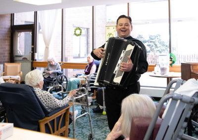 Bernie, a seminarian entertains with his accordion
